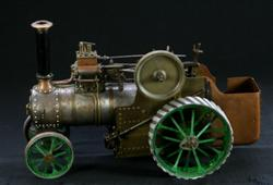 Sale 7907 - Lot 26 - Brass Steam Tractor with Green Painted Wheels (Length 38cm)
