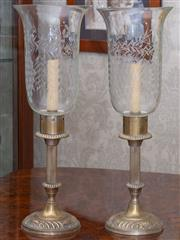 Sale 8649A - Lot 11 - A pair of etched glass storm lanterns on plated metal column bases, height 45cm