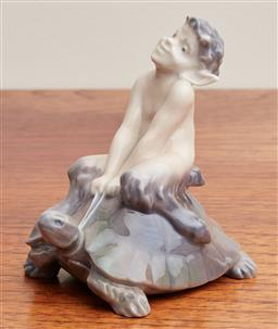 Sale 9099 - Lot 25 - A Royal Copenhagen figure of a Faun on a tortoise . Height 9cm, small chip to ear