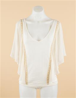 Sale 9250F - Lot 93 - A Manning Cartell silk and cotton cream top, size 12.
