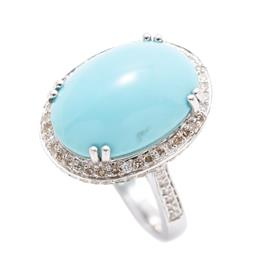 Sale 9253J - Lot 445 - A 14CT WHITE GOLD DIAMOND AND STONE SET COCKTAIL RING; featuring an oval cabochon reconstituted turquoise to surround, gallery and s...