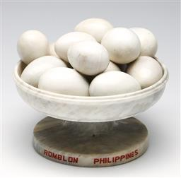Sale 9253 - Lot 316 - A white marble comport with marble eggs (Dia:22.5cm)