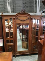 Sale 8666 - Lot 1057 - Louis XVI Style Walnut Armoire, with ribbon carved top, the centre door with mirror & rose festoon over cane panel, flanked by astra...