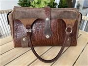 Sale 9031H - Lot 37 - Brown Leather Handbag Jasper by Dinni Wabuu, Handmade in Melbourne, L 41cm x H 23cm, bought from Hastings Street, Noosa, -