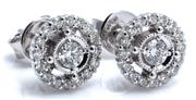 Sale 9029 - Lot 392 - A PAIR OF 18CT WHITE GOLD DIAMOND CLUSTER STUD EARRINGS; each centring a round brilliant cut diamond to a halo surround of 16 round...