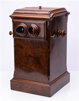 Sale 9185E - Lot 2 - A Victorian walnut stereoscopic table top viewer with slides, Height 49cm x Width 27cm x Depth 30cm, stereographs relating to the co...