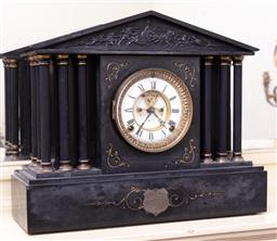 Sale 9190H - Lot 281 - An Ansonia black slate mantle clock, the pediment shaped top over a gilt framed face with Roman numerals flanked by pillars and rais...