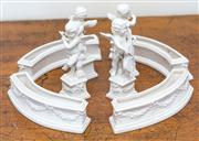 Sale 8284A - Lot 37 - A set of four Continental white porcelain cherubs, height 14cm, together with four arc shaped troughs,