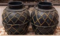 Sale 8934H - Lot 65 - A pair of blackened earthenware jars with wire net sleeves, Height 37cm