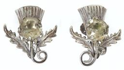 Sale 9123J - Lot 358 - A pair of Scottish silver Thistle form earrings, possibly Ward Brothers, Edinburgh C: 1950's, each set with a citrine. Earring L: 20mm