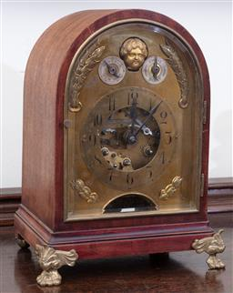Sale 9190H - Lot 140 - A French mahogany encased and brass bracket clock with husk and cherub decoration and visible escapement, striking and chiming with...