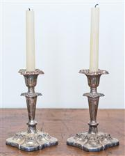 Sale 8284A - Lot 63 - A pair of Sheffield Plate Rococo style candle sticks, with removable drip trays, height 18cm