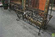 Sale 8299 - Lot 1051 - Pair of Scrolled Wrought Iron Plant Stands with Three Holders
