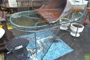 Sale 8550 - Lot 1346 - Glass Top Metal Based Oval Table