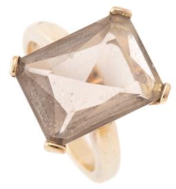 Sale 9140 - Lot 337 - A 9CT GOLD QUARTZ RING BY JAN LOGAN; corner claw set with a modified radiant cut smoky quartz of approx. 6.50ct, size M, top 16 x 12...