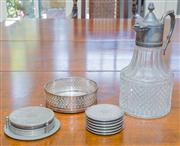 Sale 8402H - Lot 57 - An EP and glass whiskey jug, together with a bottle coaster by Strachan and associated drinks mats.