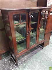 Sale 8559 - Lot 1033 - 1910/20s Mahogany Display Cabinet, with break front top, central glass panel door flanked by two astragal doors, enclosing a green v...