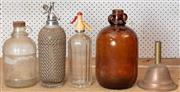 Sale 8984H - Lot 394 - A pair of soda syphones, one by Parkinsons together with a copper funnel, a brown glass demijohn and a clear example. Height of brow...