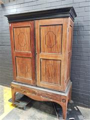 Sale 9014 - Lot 1060 - Antique Anglo-Ceylonese Satinwood & Possible Ebony Wardrobe, with a black cornice, over two panelled doors, on a raised bracket base...