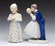 Sale 9086 - Lot 65 - A B&G figural group of a kissing couple (H19.5cm) together with a another of a girl cradling a doll (H19.5cm)