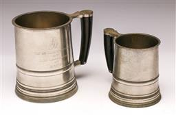 Sale 9119 - Lot 504 - Two similar Pewter tankards, midi & pint size with horn handles (H9 & 11cm)