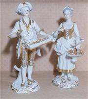 Sale 8368A - Lot 78 - A pair of German Blanc de Chine figures of male and female flower sellers, heightened in gilt, H 21cm