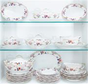 Sale 8550H - Lot 185 - A Royal Doulton part dinner service in the Temple pattern comprising tureens, sauce boats, dinner plates, saucers and serving plates...