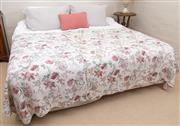 Sale 8550H - Lot 204 - A pair of single bed ensembles combined to form a king sized bed, includes bedding