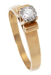 Sale 8915 - Lot 311 - AN 18CT GOLD SOLITAIRE DIAMOND RING; illusion set in platinum with an approx. 0.07ct round brilliant cut diamond, size N, wt. 3.55g.