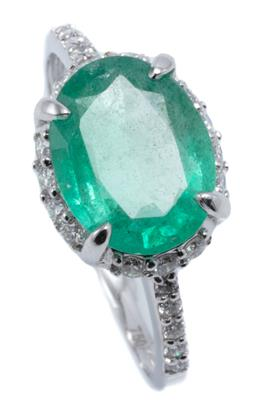 Sale 9054J - Lot 168 - AN 18CT WHITE GOLD EMERALD AND DIAMOND RING; claw set with a 2.22ct oval cut emerald to surround and shoulders set with 24 round bri...
