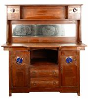 Sale 9048A - Lot 24 - A Liberty style oak sideboard with bevelled mirror above a central niche, drawers and doors each side, top and bottom, the hand beat...