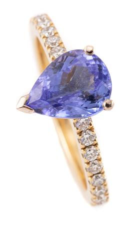 Sale 9194 - Lot 523 - AN 18CT GOLD TANZANITE AND DIAMOND RING; 3 curved bar claw set with an approx. 1.90ct pear cut tanzanite between shoulders set with...