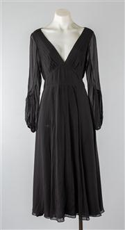 Sale 8740F - Lot 247 - A DKNY black silk tunic dress with tie sash to waist, stitched rib detailing and softly fluted hem, size 6