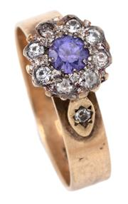 Sale 9066 - Lot 376 - A SAPPHIRE AND STONE SET CLUSTER RING; centring a round cut purple sapphire of approx. 0.32ct to surround and shoulders of round cut...