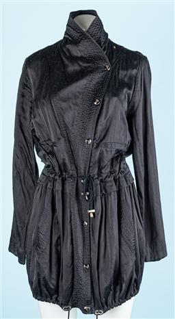 Sale 9091F - Lot 218 - A KENZO 3/4 LENGTH DRAWSTRING COAT OF UNIQUE WRAP DESIGN; in black silk, with silver buttons and drawstring hem, Size EUR 48