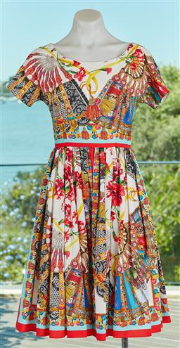 Sale 9092F - Lot 61 - A DOLCE & GABBANA PRINTED DRESS; with zip up back and two side pockets, size 38