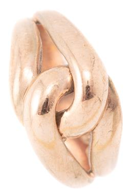 Sale 9140 - Lot 343 - A 9CT ROSE GOLD RING; featuring a double love knot on cojoined bands, size M, width 11mm, wt. 4.37g.
