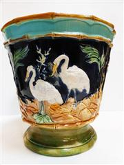 Sale 8272A - Lot 29 - An Antique English majolica garden pot  decorated with storks. Size; 26 x 27 cm. (possible professional restoration to rim)