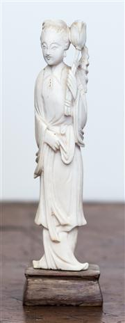 Sale 8284A - Lot 59 - An Oriental ivory figure of a lady bearing a lotus in flowing robes, height 17cm