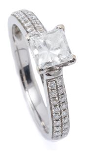 Sale 8999 - Lot 384 - AN 18CT WHITE GOLD DIAMOND RING; claw set with a princess cut diamond of approx. 0.69ct D/SI, to upswept shoulders set with 36 round...
