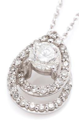 Sale 9221 - Lot 389 - A 10CT WHITE GOLD DIAMOND PENDANT NECKLACE; centring a round brilliant cut diamond of approx. 0.30ct to a 2 row spiral pear shape su...