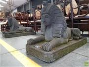Sale 8576 - Lot 1077 - Pair of Volcanic Rock Egyptian Sphinxes, on rectangular plinths