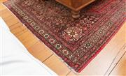 Sale 8595A - Lot 68 - A Shiraz Persian wool carpet with all over pattern with rose and chocolate brown field, some flaws, 160 x 210cm