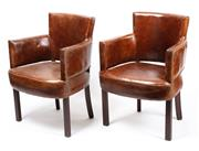 Sale 8912H - Lot 62 - A pair of brown leather armchairs with studwork detail, Height 86cm x Width 61 x Depth 58cm