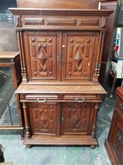 Sale 8917 - Lot 1034 - Early 20th Century French Oak Buffet a Deux Corps, with geometric panel doors above and below two short drawers, flanked by columns