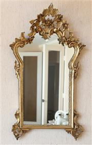 Sale 8250 - Lot 49 - An 18th Century Style Giltwood Wall Mirror ,  modelled with a pierced foliate carved frame, enclosing original mirror plate , h