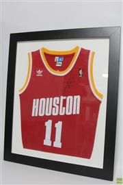 Sale 8551 - Lot 95 - Framed Houston Rockets Vintage Jersey