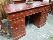 Sale 8559 - Lot 1007 - Victorian Mahogany Pedestal Desk, with red leather top & fitted with nine drawers