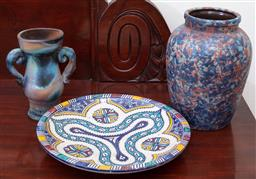 Sale 9190H - Lot 223 - A Mexican decorative earthenware plate Dia27cm, together with a continental baluster vase with spatter decoration, Height 22cm, and...