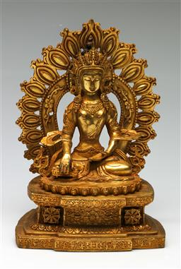 Sale 9209V - Lot 64 - A gilded cast metal Tara, seated with halo to back (H: 28cm)